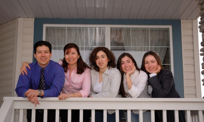 Salvadoran immigrant and author Joaquin Benitez poses with his family. Canada marks Multiculturalism Day on June 27, and Benitez says the occasion reminds him of the limitless opportunities available for newcomers to the country. (Raymond and Liezl Chiang)