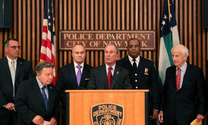 Mayor Michael Bloomberg, NYPD Commissioner Raymond Kelly, district attorneys and police union leaders, update New Yorkers on June 24, 2013, on City Council bills that Bloomberg says will inhibit policing and make New York City less safe. (Spencer T. Tucker)