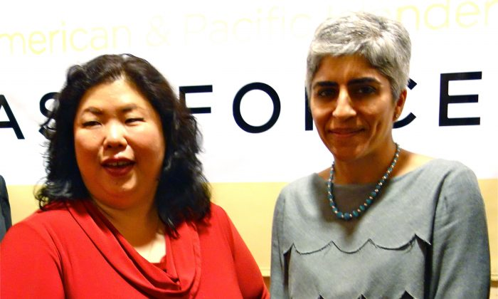 (L-R) Attorney Bonnie Youn and Kiran Ahuja, executive director of the White House Initiative on Asian Americans and Pacific Islanders, at a reception for Ahuja at Ashiana Restaurant in Norcross, Georgia on June 27, 2013. (Mary Silver/Epoch Times)