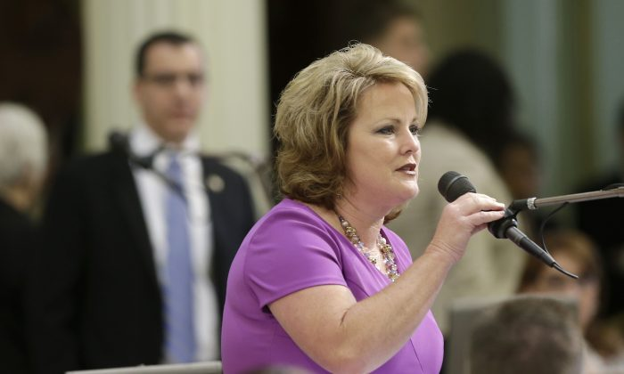 Assemblywoman Shannon Grove (R-Bakersfield) urges lawmakers to reject measure, carried by Assemblyman Bob Blumenfield, D-Woodland Hills (L), chair of the Assembly budget committee, to undo changes in a budget bill that could restrict access to public records held by local governments, at the Capitol in Sacramento, Calif., June 20, 2013. By a 52-25 vote, the Assembly approved the measure SB71, that withdraws the language giving local governments the option to comply with the California Public Records Act. (AP Photo/Rich Pedroncelli)