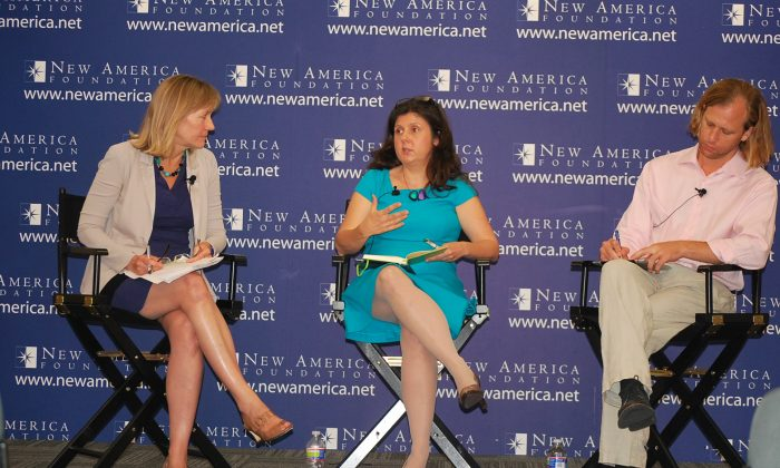Liza Mundy (left) discuss the economics of marriage with Betsey Stevenson, professor of public policy at the University of Michigan and her partner Justin Wolfers, economist and professor at the New America Foundation on June 12. Stevenson was formerly Chief economist at the U.S. Department of Labor. (Ron Dory/Epoch Times)