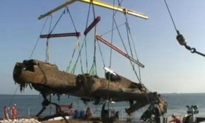 German WWII bomber, a Dornier 17, is recovered from the Goodwin Sands off the coast of Kent, England, on June 10, 2013. (Screenshot/BBC)