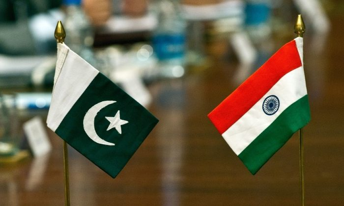 A file photo showing Pakistani (L) and Indian flags on a table during an Indo-Pak meeting on the Sir Creek region dispute in New Delhi on June 18, 2012. Sir Creek, which opens up into the Arabian Sea dividing the Kutch region of the Indian state of Gujarat with the Sindh province of Pakistan, is a 96-km strip of water that is disputed between India and Pakistan. (Prakash Singh/AFP/GettyImages)