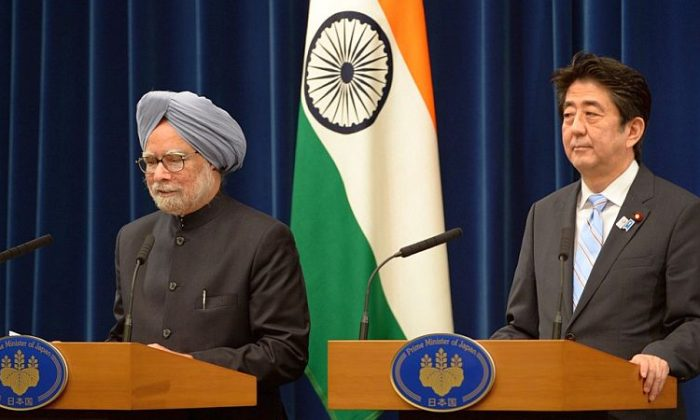Indian Prime Minister Manmohan Singh (L) delivers his speech beside his Japanese counterpart Shinzo Abe (R) during their joint statement announcement at Abe's official residence in Tokyo on May 29, 2013. The two nations pledged to cooperate in ensuring security in the Asia-Pacific region. Both nations face of maritime security threats from China. (Toshifumi Kitamura/AFP/Getty Images)