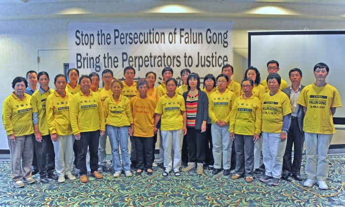 25 Falun Gong practitioners formerly held as prisoners of conscience at Chinese brainwashing labor camps and prisons, at a press conference at the Hilton Garden Inn in Rancho Mirage, CA on June 6, 2013. President Obama and Chinese Communist Party leader Xi Jinping will be in meetings June 7 and 8 in the same city. (Robin Kemker/The Epoch Times)