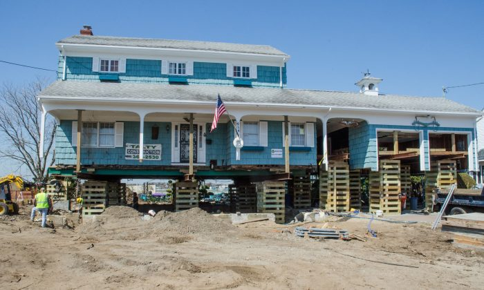 After the storm surge from Hurricane Sandy flooded their house with 5 feet of water, the homeowners made the decision to elevate their house above the new flood level of 12 feet determined by New York State and FEMA in Freeport, N.Y., May 20. (Kenneth Wilsey/FEMA)