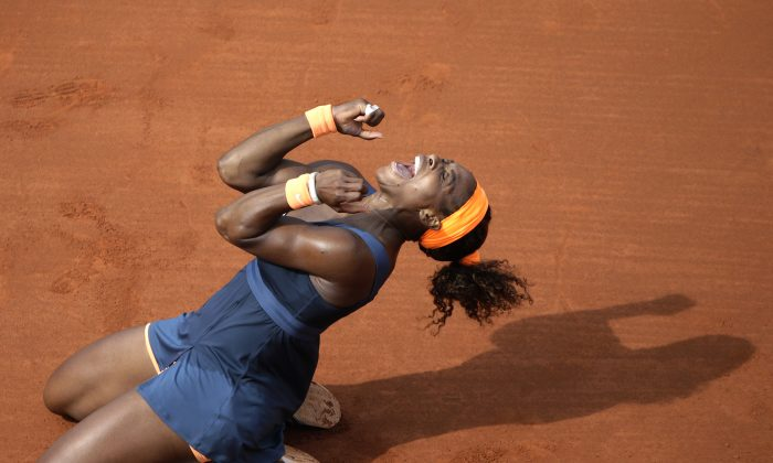 Serena Williams celebrates her victory over Maria Sharapova at the end of their French Open women's singles final match at the Roland Garros stadium in Paris on June 8, 2013. (Kenzo Tribouillard/AFP/Getty Images)