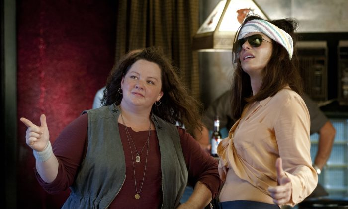 "Uptight FBI Special Agent Sarah Ashburn (R, Sandra Bullock) is paired with testy Boston cop Shannon Mullins (L, Melissa McCarthy) in order to take down a ruthless drug lord in the action-comedy ""The Heat.""  (Gemma La Mana/ Twentieth Century Fox Film Corporation)"