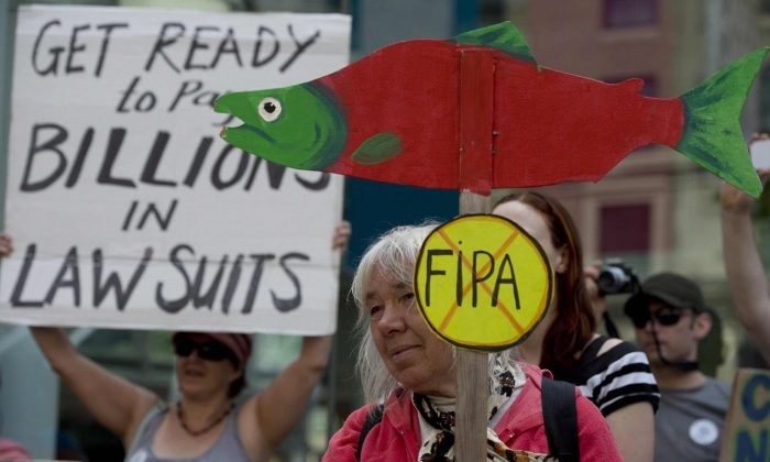 Demonstrators protest the Canada-China Foreign Investment Promotions and Protection Agreement Wednesday outside the federal court where a hearing is being held in downtown Vancouver. (THE CANADIAN PRESS/Jonathan Hayward)