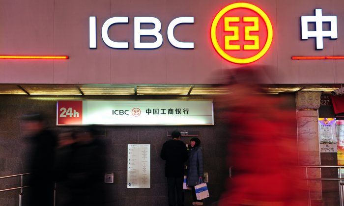 Customers use an automated teller machine at a branch of the Industrial and Commercial Bank of China in Beijing, on January 29, 2011. Chinese banks are suffering from a funding crisis and have suspended lending in some branches as a result. (Frederic J. Brown/AFP/Getty Images)