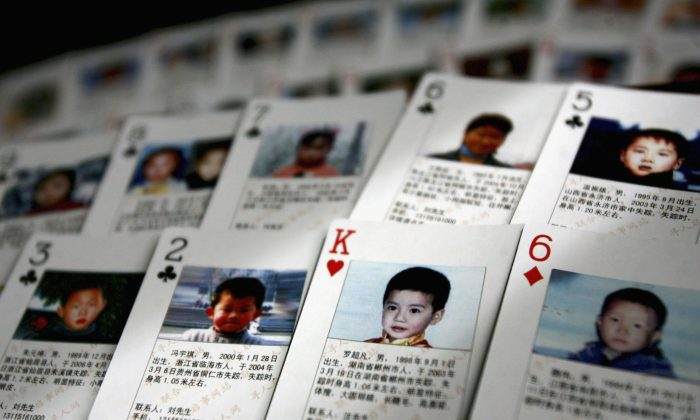 Playing cards showing details of missing children are displayed in 2007 in Beijing, China. The cards showing photographs and information of 27 missing children were created by Shen Hao, the founder of a missing persons website to be handed out in areas notorious for child trafficking. China has just been put on a list of countries of serious concern for human trafficking. (China Photos/Getty Images)