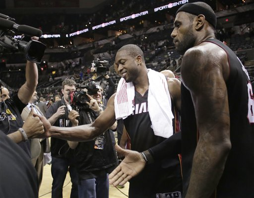 Miami Heat's Dwyane Wade, left, and LeBron James leave the floor after beating San Antonio Spurs at Game 4 of the NBA Finals basketball series, Thursday, June 13, 2013, in San Antonio. The Heat won 109-93. (AP Photo/Eric Gay)