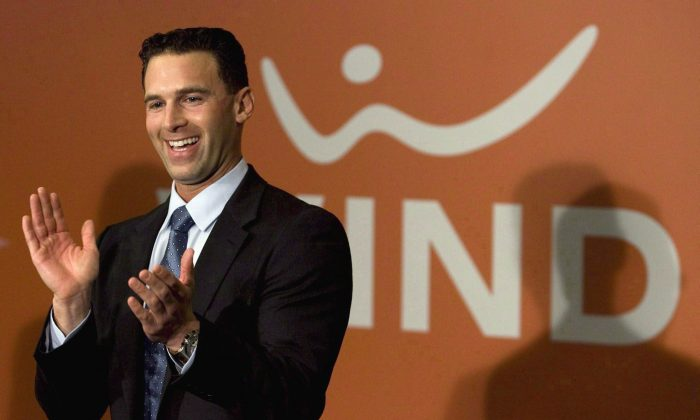 Globalive and Wind Mobile chairman Anthony Lacavera claps during a press conference in Toronto on December 11, 2009. Wind Mobile would like to open talks to buy Mobilicity in a bid to create a fourth national wireless competitor, Lacavera said Wednesday. (THE CANADIAN PRESS/Darren Calabrese)