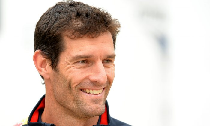 Red Bull Racing's Australian driver Mark Webber smiles in the paddock at the Silverstone circuit in Silverstone on July 27, 2013 ahead of the British Formula One Grand Prix. (Andrew Yates/AFP/Getty Images)