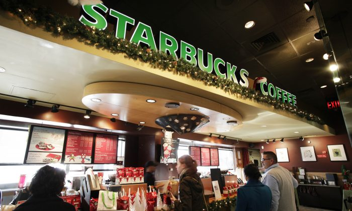Starbucks has tied up with Google to provide faster WiFi Internet services in its stores. (AP Photo/Mark Lennihan)