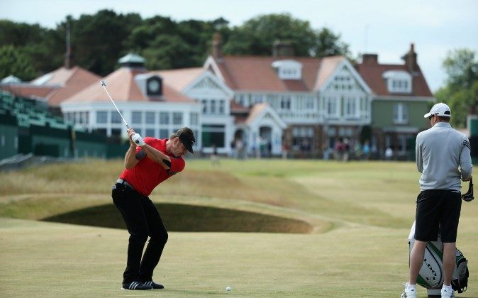 Sir Nick Faldo of England hits a shot on the 18th hole ahead of the 142nd Open Championship at Muirfield on July 15, 2013, in Gullane, Scotland. (Andy Lyons/Getty Images)