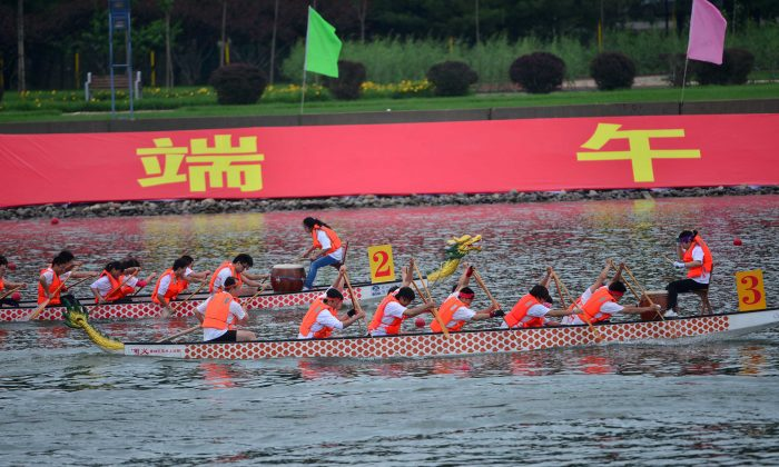 Boats race to mark the Dragon Boat Festival in Beijing. (STR/AFP/Getty Images)