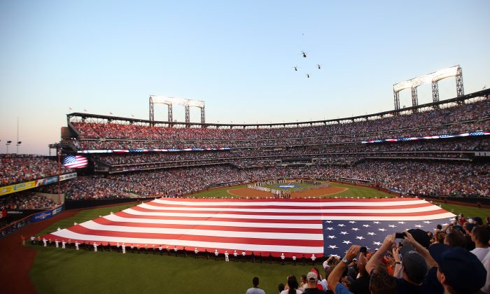 The American National Anthem is sung as the flag covers the field before the 84th MLB All-Star Game at Citi Field in Flushings, Queens, New York City on July 16, 2013. (Bruce Bennett/Getty Images)