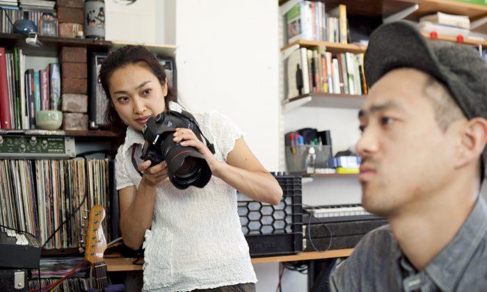 Photographer Misaki Matsui photographs Keita Jo, composer / sound designer, in his home/studio in Long Island City on July 29. (Samira Bouaou/Epoch Times)