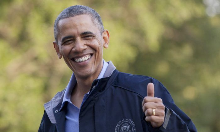 President Barack Obama give the thumbs up as walks from Marine One the the White House, Friday, July 26, 2013, in Washington, as he arrives after spending the day at Camp David with members of his cabinet and their families. (AP Photo/Carolyn Kaster)