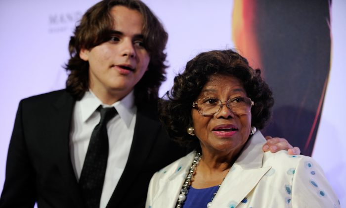 """Prince Jackson, left, and Katherine Jackson arrive at the world premiere of """"Michael Jackson ONE"""" on June 29, 2013. (David Becker/Invision/AP, File)"""