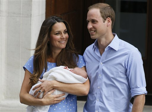 Britain's Prince William, right, and Kate, Duchess of Cambridge hold the Prince of Cambridge, Tuesday July 23, 2013, as they pose for photographers outside St. Mary's Hospital exclusive Lindo Wing in London where the Duchess gave birth on Monday July 22. The Royal couple are expected to head to London's Kensington Palace from the hospital with their newly born son, the third in line to the British throne. (AP Photo/Kirsty Wigglesworth)