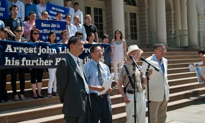 Chinese residents stand at the steps of City Hall in New York City on July 8, as they called for the arrest of NYC comptroller John Liu. (Joshua Philipp/Epoch Times Staff)