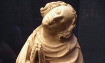 Sculpture of Saint Elzéar: Taking It on the Cheek