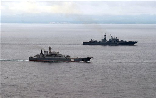 Russian Pacific Navy ships sail near the Sakhalin Island during military exercises on Tuesday, July 16, 2013. The maneuvers in Siberia and the far eastern region involved 160,000 troops and about 5,000 tanks - a massive show of force unprecedented since the Soviet times. (AP Photo/RIA Novosti, Alexei Nikolsky, Presidential Press Service, Pool)