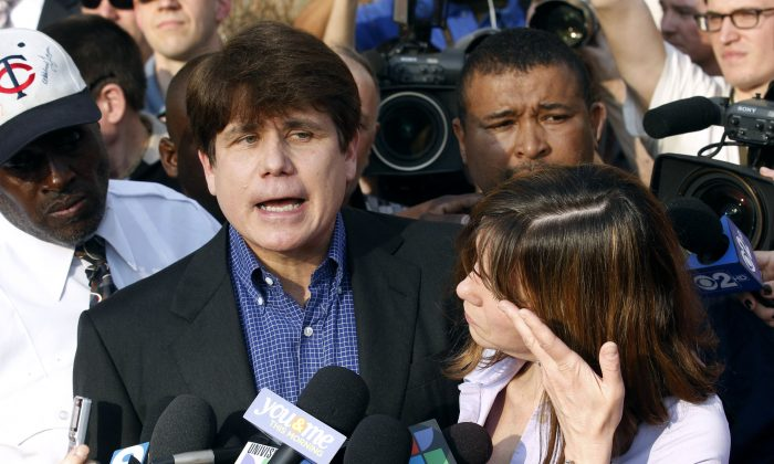 In this March 14, 2012 file photo, former Illinois Gov. Rod Blagojevich speaks to the media outside his home in Chicago. Lawyers for Blagojevich filed an appeal to reduce the ex-governor's sentence related to a corruption case. (AP Photo/M. Spencer Green)