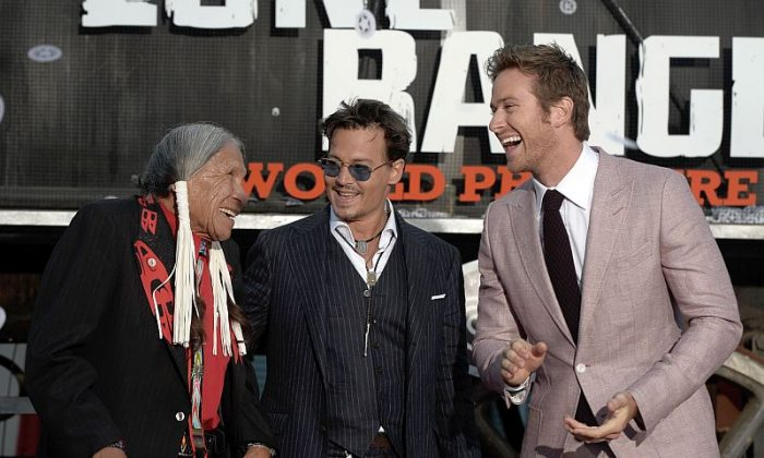 """Actors Saginaw Grant, Johnny Depp, and Armie Hammer arrive at the premiere of """"The Lone Ranger"""" at Disney California Adventure Park on June 22 in Anaheim, Calif. (Kevin Winter/Getty Images)"""