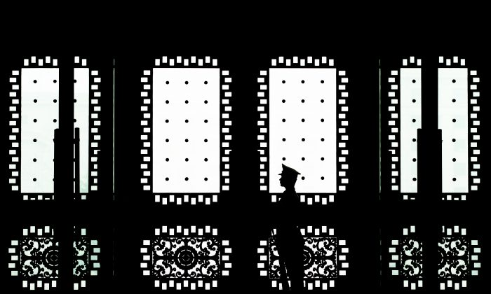 A Chinese soldier stands guard at the main entrance door of the Bayi building, on April 23, 2013, in Beijing, China. The Chinese regime runs networks of military hackers who target U.S. businesses and government offices. (Andy Wong/Getty Images)