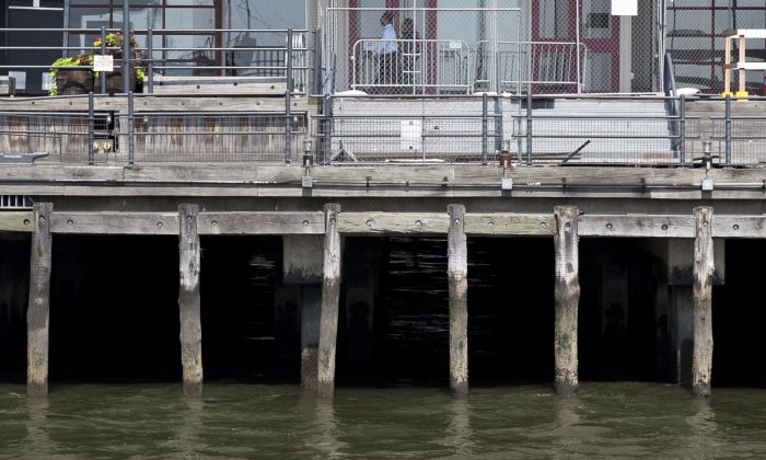 Wooden pier pilings at South Street Seaport, New York City, on Aug. 23, 2013. (Samira Bouaou/Epoch Times)