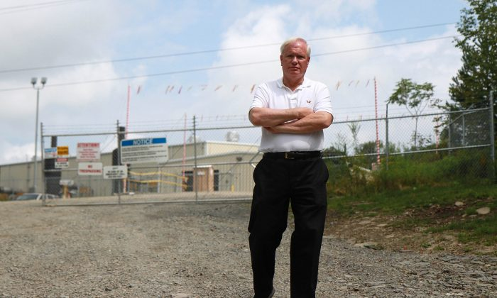 Sen. Tony Avella walks in front of the Williams Compressor Station near Montrose, Pa., Aug. 28, 2013. The Williams Compressor Station, which helps transport gas from wells in the area, caught fire on May 15, 2013. (Kristen Meriwether/Epoch Times)