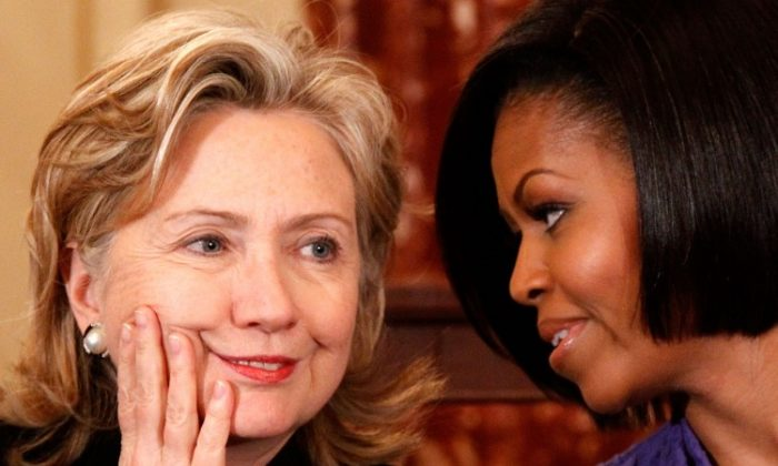 U.S. Secretary of State Hillary Rodham Clinton (L) and first lady Michelle Obama (R) share a moment during the fourth annual Award for International Women of Courage ceremony at the State Department March 10, 2010, in Washington, D.C. The award was to pay tribute to outstanding women leaders worldwide; the idea is now floating around in the press that Clinton and Obama should be running mates in the 2016 presidential elections. (Alex Wong/Getty Images)