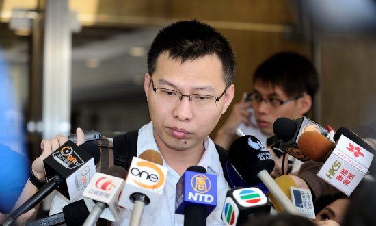 Journalist Brings Powerful Chinese Businessman to Bay in Hong Kong