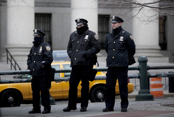 "New York CIty Police officers stand near a demonstration against the city's ""stop-and-frisk"" searches in lower Manhattan near Federal Court, New York, March 18, 2013. (Allison Joyce/Getty Images)"