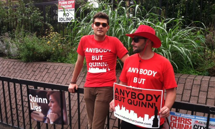 Vincent Di Santo (R) and Noah (asked for last name not to be used) at an Anybody But Quinn rally in Greenwich Village, New York City, Aug. 28, 2013. (Genevieve Belmaker/Epoch Times)