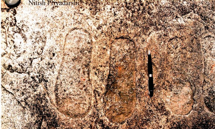 Footprints on a rock in Piska Nagri village, on the outskirts of Ranchi City in Jharkahnd State, India. Probably thousands of years old, these footprints are engraved on granite rock by the earlier inhabitants of the area and are believed by the locals to be those of king gods Rama and Lakshmana. (NITISH PRIYADARSHI)
