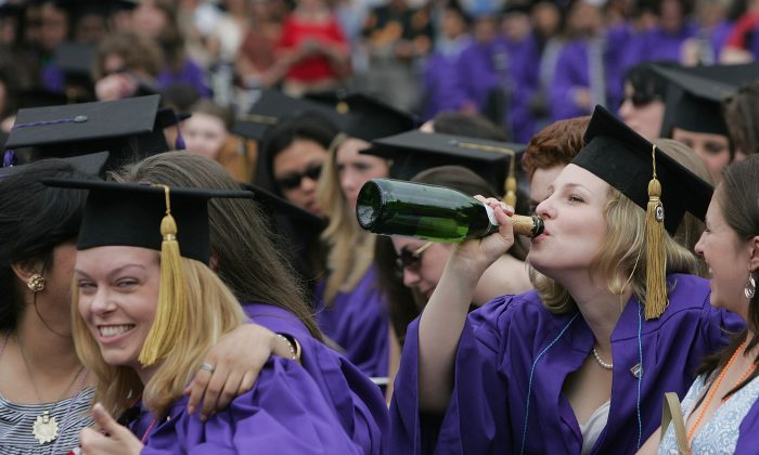 A file photo of New York University College of Arts and Science graduates celebrating with a drink at a graduation ceremony in Washington Square Park. (Mario Tama/Getty Images)