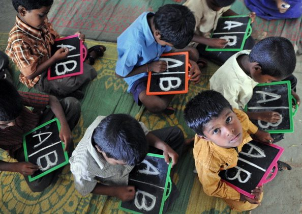 Indian school children write alphabets on slates at a government primary school in the outskirts of Hyderabad on June 13, 2011. India has lost almost 250 languages in the last 50 years, but still continues to have four times the languages spoken in Europe according to a recent survey. (NOAH SEELAM/AFP/Getty Images)