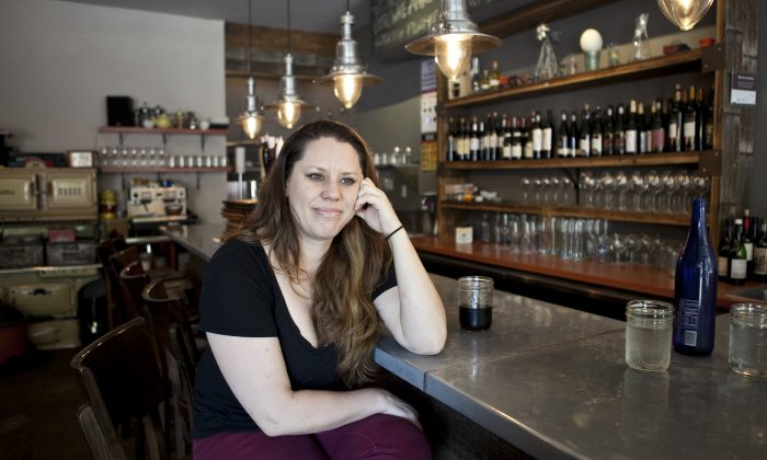 Suzaan Hauptfleisch, owner of Kaia Wine Bar, on the Upper East Side on Aug. 27. She spoke about her experience growing up on a farm during apartheid-era South Africa. (Samira Bouaou/Epoch Times)