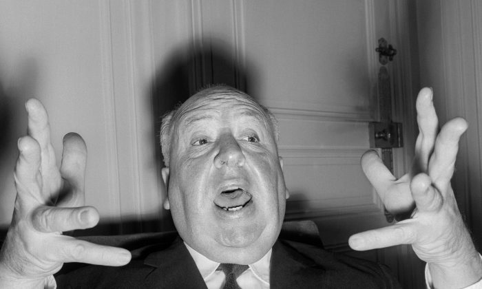 British film director Alfred Hitchcock (1899-1980) gestures as he gives a press conference in Paris to present his last movie 'Psycho' 18 October 1960. Given his chosen genre, it is a strange coincidence that he would have turned 100 years old on a Friday 13th. (STF/AFP/Getty Images)