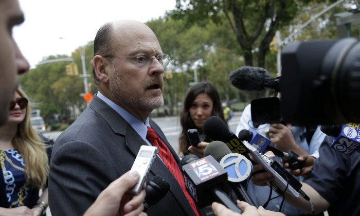 Republican mayoral hopeful Joe Lhota speaks to reporters after voting in the primary election in New York City, Sept. 10, 2013. (AP Photo/Seth Wenig)