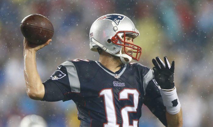 Tom Brady #12 of the New England Patriots throws a pass in the rain in the third quarter against the New York Jets during the game at Gillette Stadium on September 12, 2013 in Foxboro, Massachusetts. (Jared Wickerham/Getty Images)