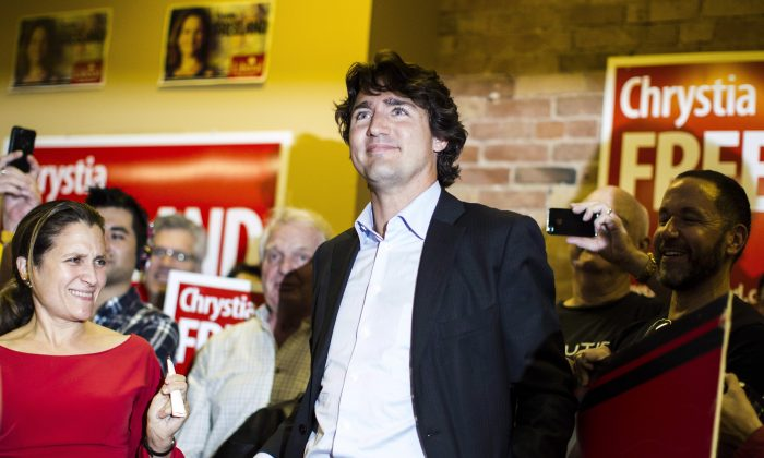 Liberal Leader Justin Trudeau attends a campaign rally for byelection candidate Chrystia Freeland (L) at her Toronto Centre campaign office on Wednesday Oct. 2, 2013. (The Canadian Press/Chris Young)