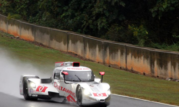 """The DeltaWing LM12 coupe, with Katherine Legge at the wheel, bids """"Au Revoir"""" to the ALMS while lapping Road Atlanta in the rain Thursday afternoon. (Chris Jasurek/Epoch Times)"""