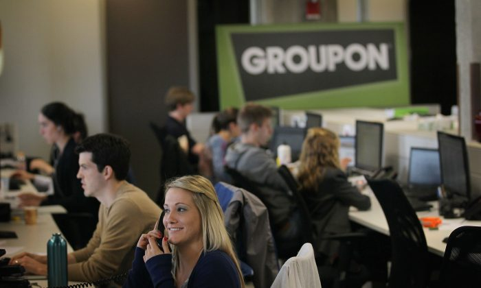 Groupon employees are seen at the company's headquarters in 2011 in Chicago. E-commerce site Groupon's stock price has gained over 135 percent since Jan. 1. (Scott Olson/Getty Images)