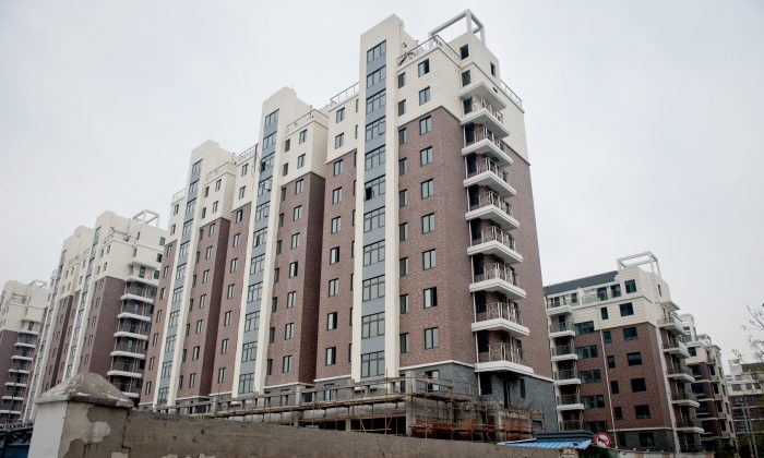 A group of apartments that were built in Hangzhou, capital of Zhejiang Province, sit vacant, as the construction company has gone bankrupt, on on April 10, 2012. Also in Hangzhou, the developer China Metallurgical Group Corporation faces huge losses, as the local governments do not have the money to pay off debts to the company. (STR/AFP/Getty Images)