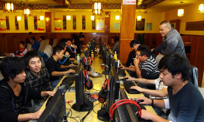 """This picture taken on Nov. 2, 2012 shows a group of people at an Internet cafe in Jiashan, east China's Zhejiang province. """"The Chinese underground market is hidden to the public but is not very difficult to find,"""" the report states. (AFP/AFP/Getty Images)"""